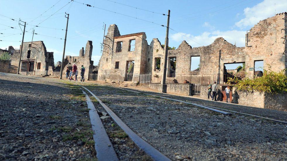 Vandals scrawl Holocaust-denying graffiti on memorial at French massacre village