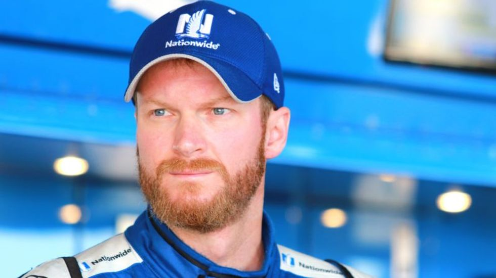 Racing star Dale Earnhardt Jr. defies NASCAR owners to show solidarity with NFL protesters