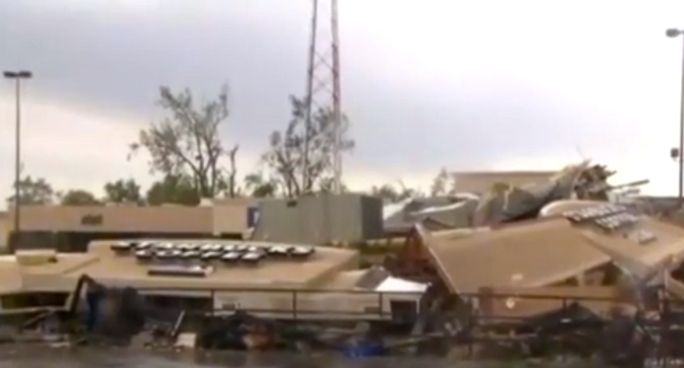 Tornadoes rip through central Indiana, demolishing homes and businesses