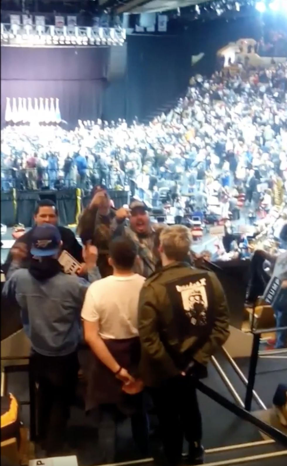 WATCH: Enraged Trump supporter puts protester in a headlock and tries to drag him away