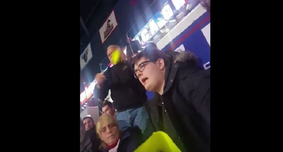 WATCH: Enraged Trump supporters attack man for quietly sitting with 'America's Already Great' sign