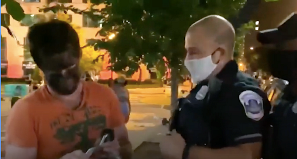WATCH: Man shows up to White House protest wearing blackface – and gets punched in the head