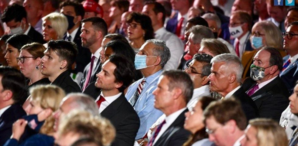 'Everybody is going to catch this thing eventually': Senior Trump official brushes off criticism of maskless crowd at RNC