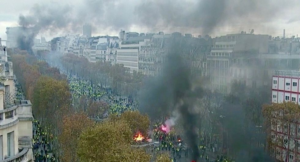 WATCH: Utter anarchy on Champs-Elysees as Paris erupts in fiery protests over fuel prices