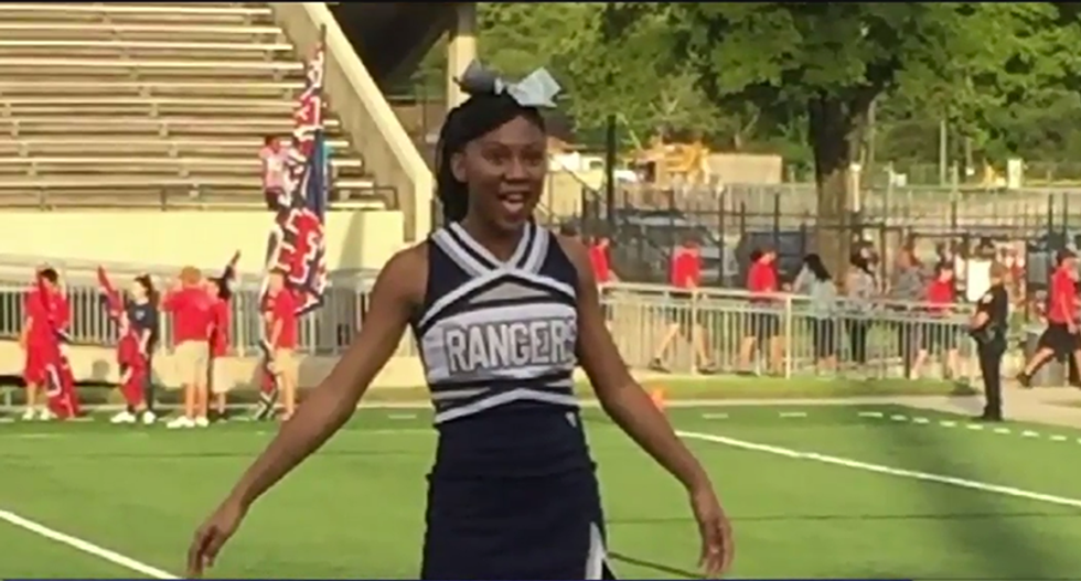 Texas coach threatens to ban squad's only black cheerleader over her braids