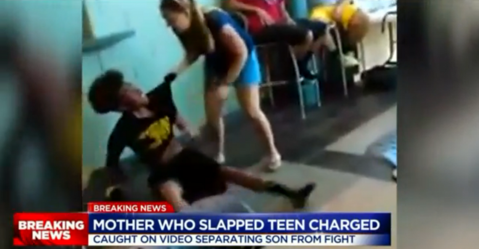 WATCH: Screaming white mom grabs black teen and slaps him across the face after school brawl