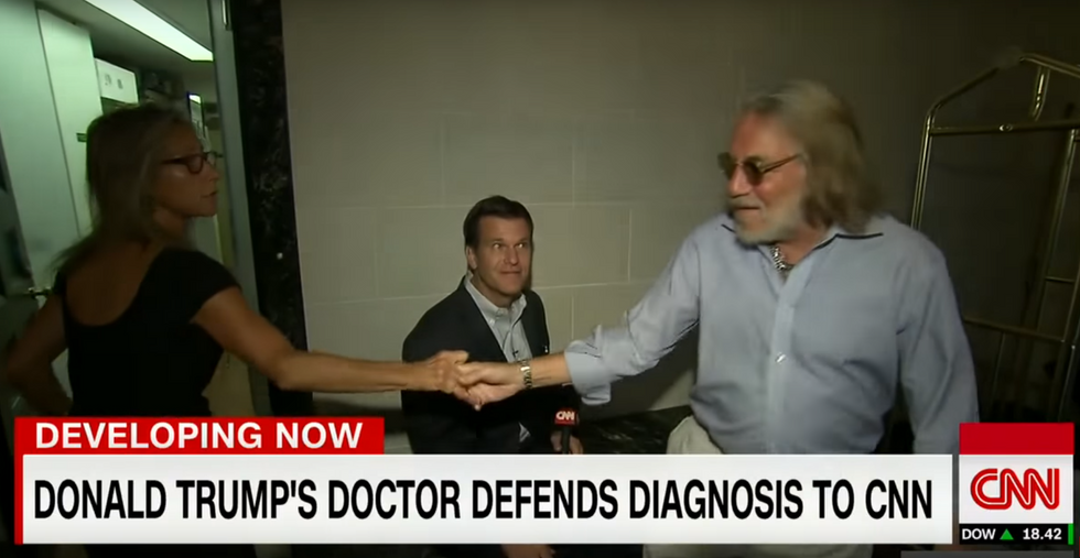 WATCH: Trump doctor's wife threatens to call the cops on CNN during interview