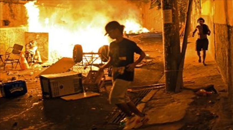Violent protest hits fabled Rio beach district after dancer is beaten to death