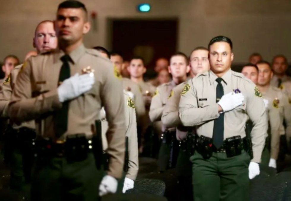 Gunman charged in 'cold-blooded' shooting of two Los Angeles police