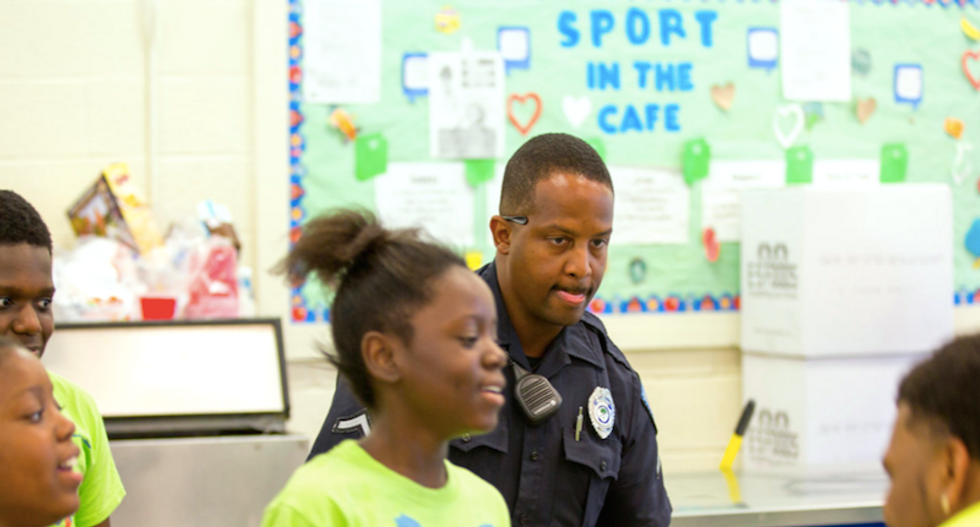 Why are police officers inside public schools?