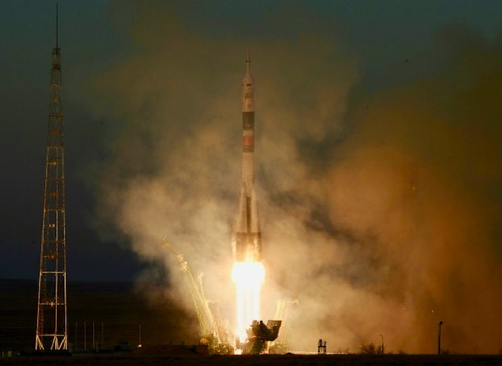Soyuz arrives at ISS on first manned mission since October failure