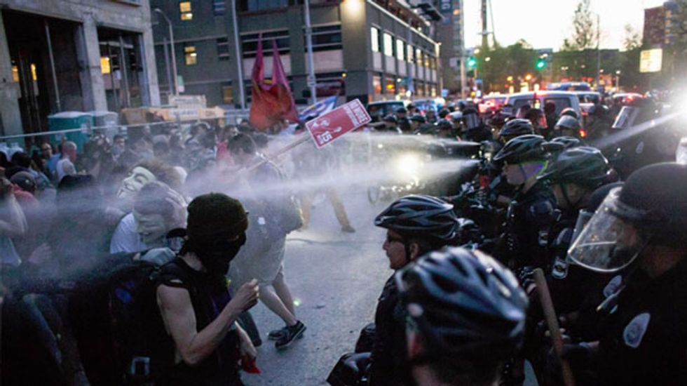 Nine people arrested in Seattle after May Day protesters throw bottles at police