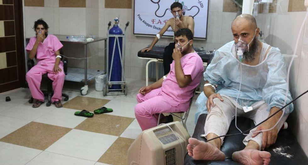 'Dozens choke' in Syria's Aleppo after barrel bomb attacks