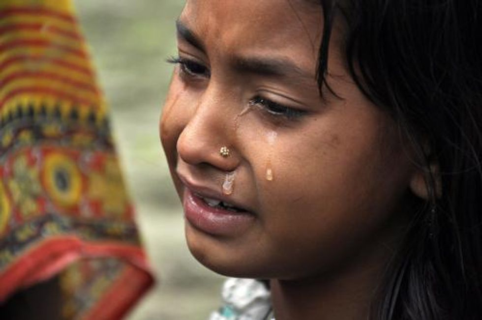 India appeals for calm after 32 Muslim women, children are shot to death in their sleep