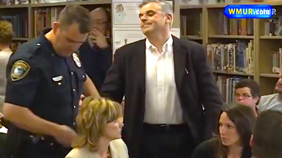 NH dad dares cops to arrest him during school board protest of controversial book assignment