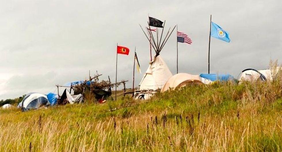 US government seeks halt to Dakota oil pipeline, after judge approves it
