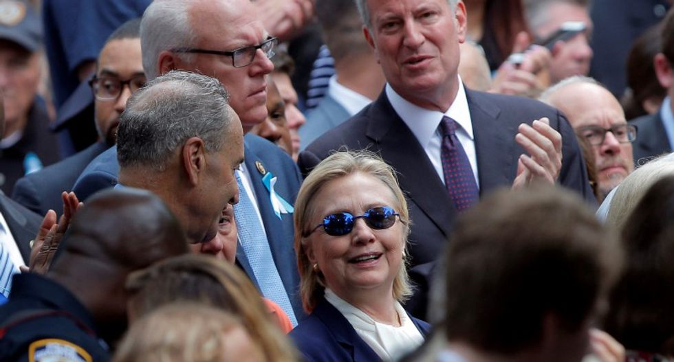 Hillary Clinton left 9/11 memorial early after feeling 'overheated': aide