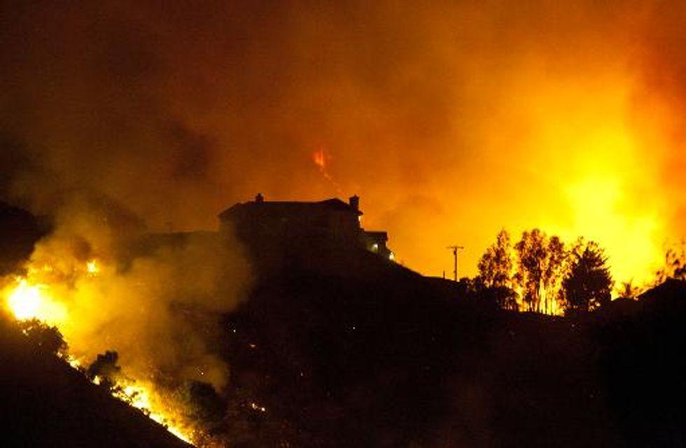 Wildfires rage across San Diego County