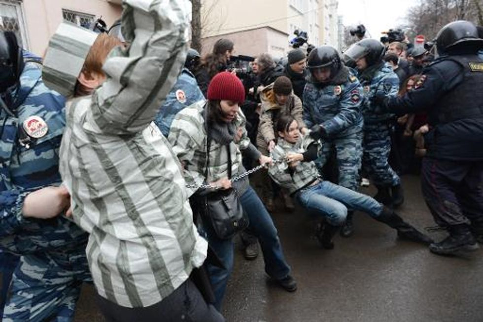 Russia sentences seven anti-Putin activists to prison, detains 200 protesters