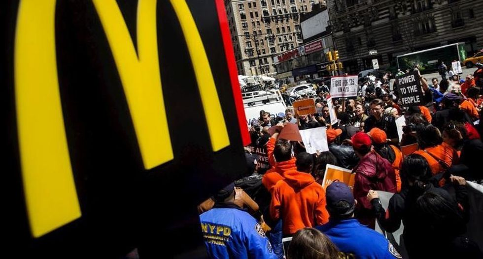 Fight for $15: Thousands of fast-food workers protest ahead of annual McDonald's meeting