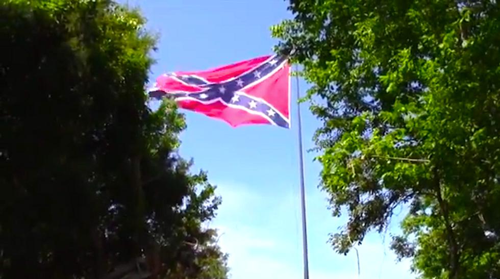 Virginia group hoists second huge Confederate flag along interstate