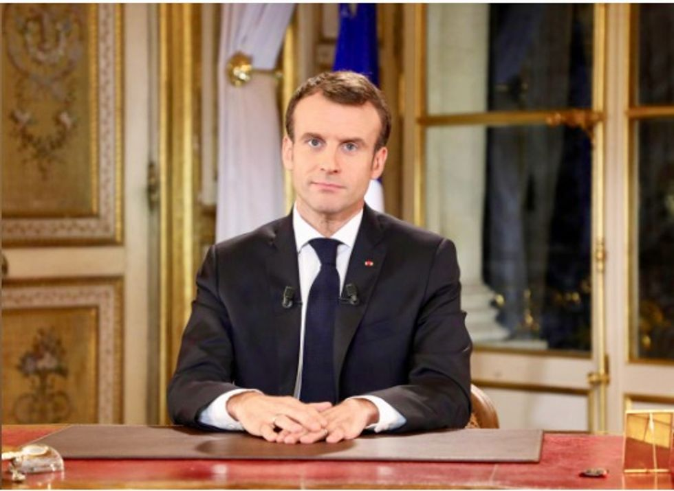 France's Macron to speed up tax cuts, raise wages, vows no U-turn