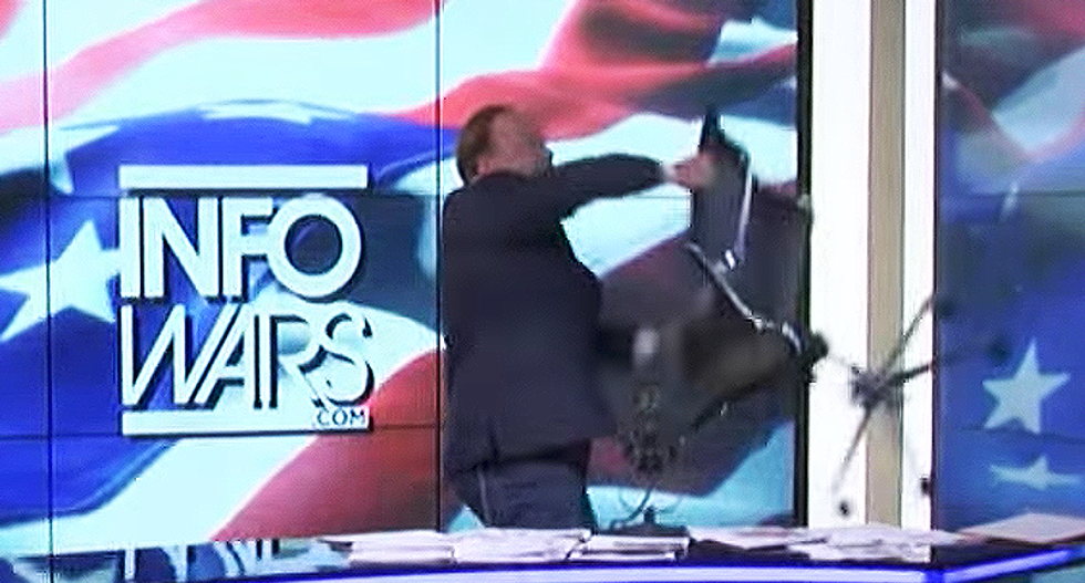 Alex Jones has the ultimate ragegasm over kids' story time with drag queens — and throws a chair