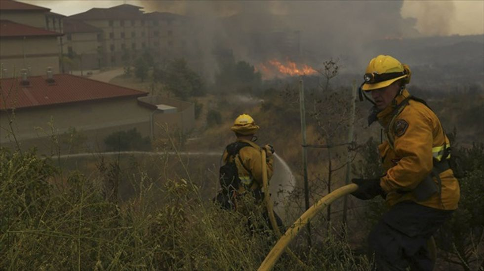 Firefighters begin to gain ground against rash of San Diego wildfires