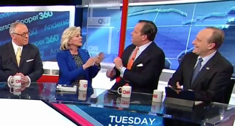 WATCH:  CNN panel devolves into chaos after Trump backer claims the president is 'protecting America' from Putin