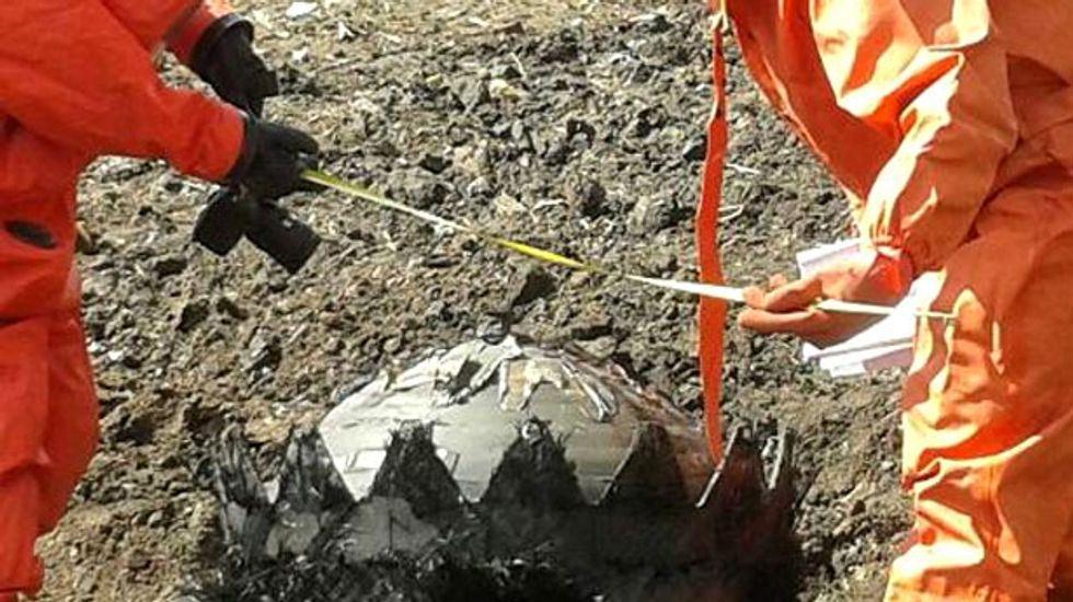 Objects that fell from sky were space debris from rocket or satellite, China says