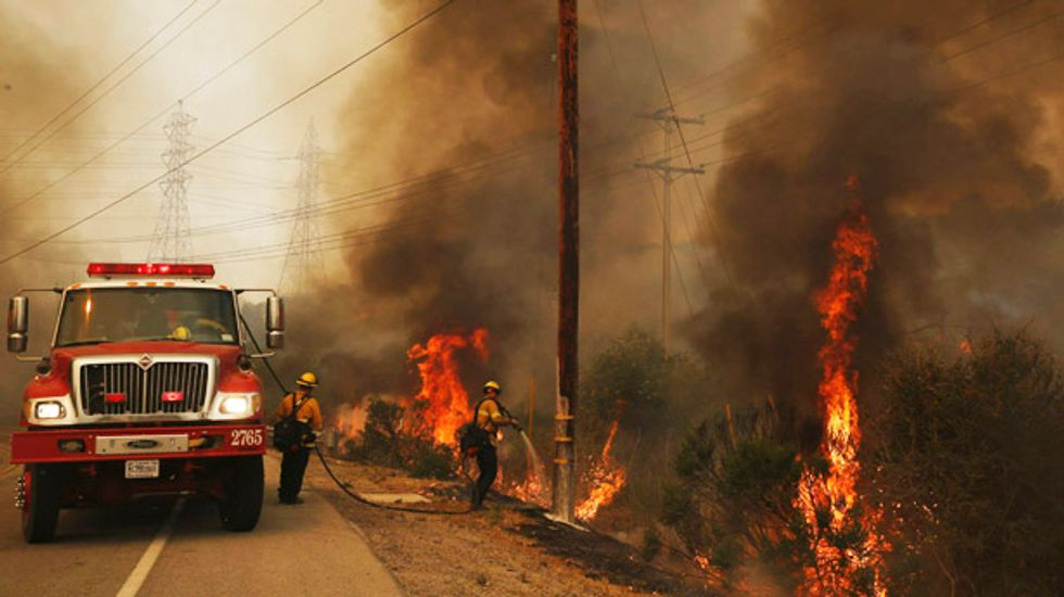 Firefighters aided by cooling temperatures subduing San Diego wildfires