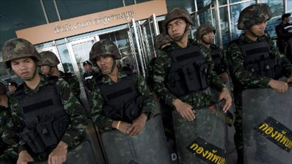 Thailand's army invokes martial law but insists it is not staging a coup