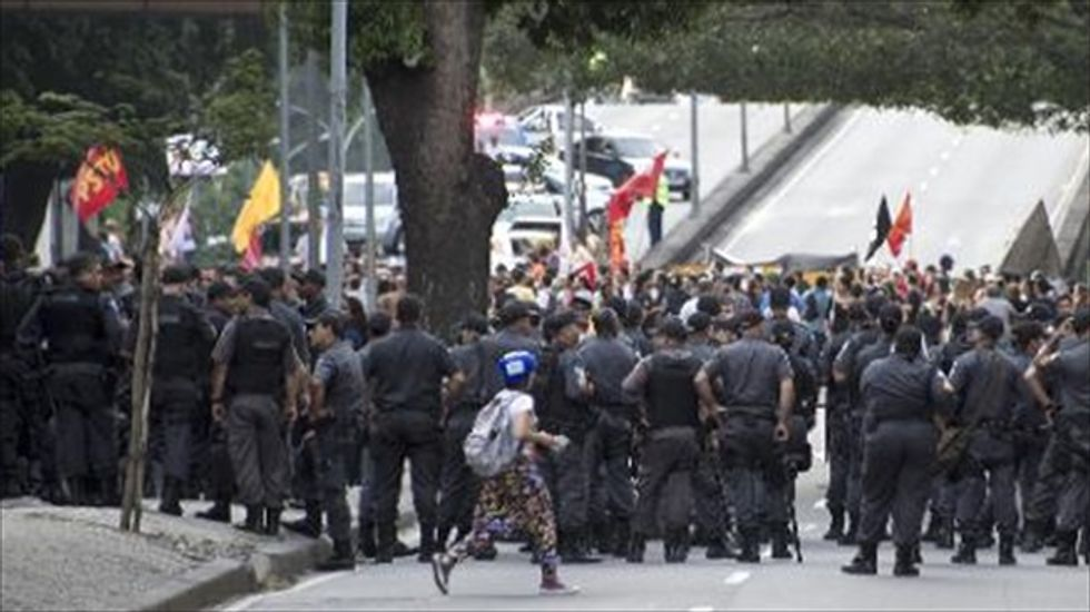 Brazil mobilizes 157,000 cops and troops for World Cup security