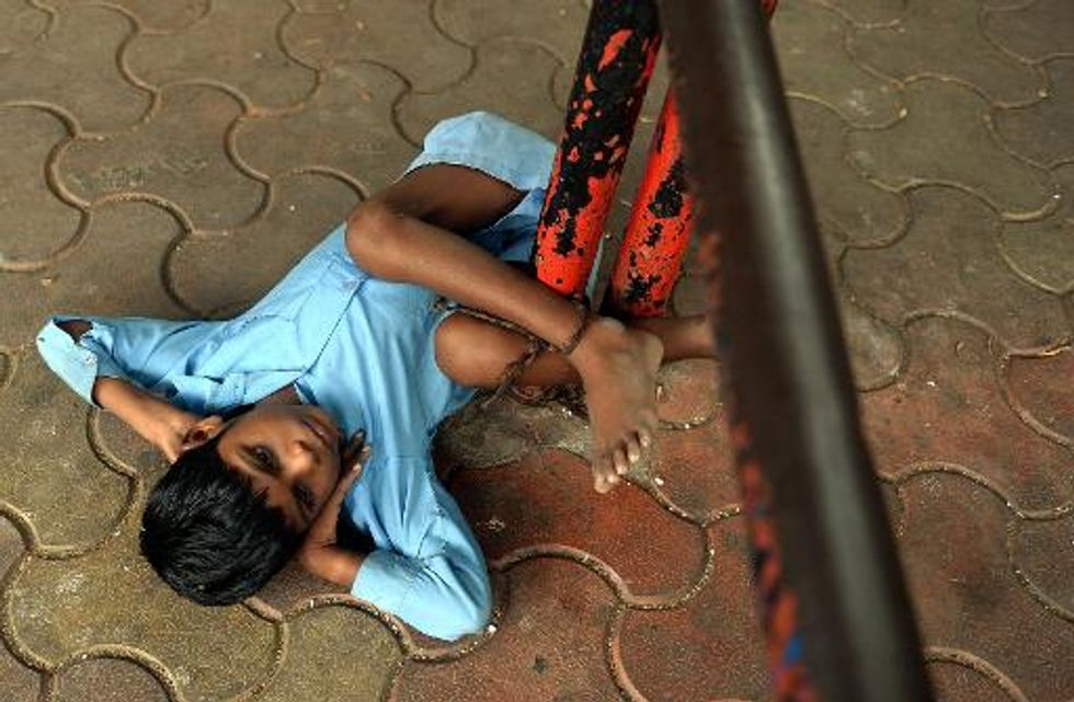 Boy tied to bus stop highlights struggle for disabled Indians