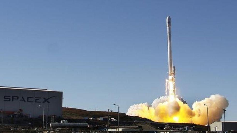SpaceX unveils sleek new Dragon cargo spaceship to fly U.S. astronauts