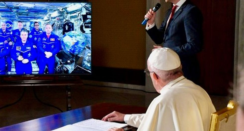 Earth is fragile, Pope Francis tells astronauts who see planet from 'eyes of God'