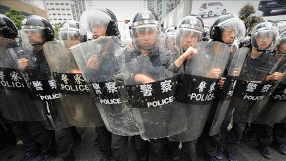China detains Hong Kong journalists over 'illegal publication'