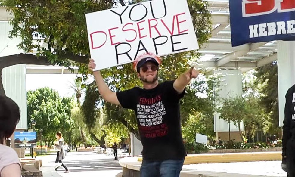 Students celebrate as infamous 'You Deserve Rape' campus preacher arrested for kicking woman