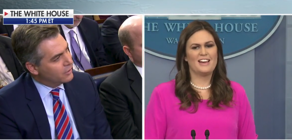 'How is that not collusion?' Reporters hammer Sarah Huckabee Sanders after Trump's former aides get indicted