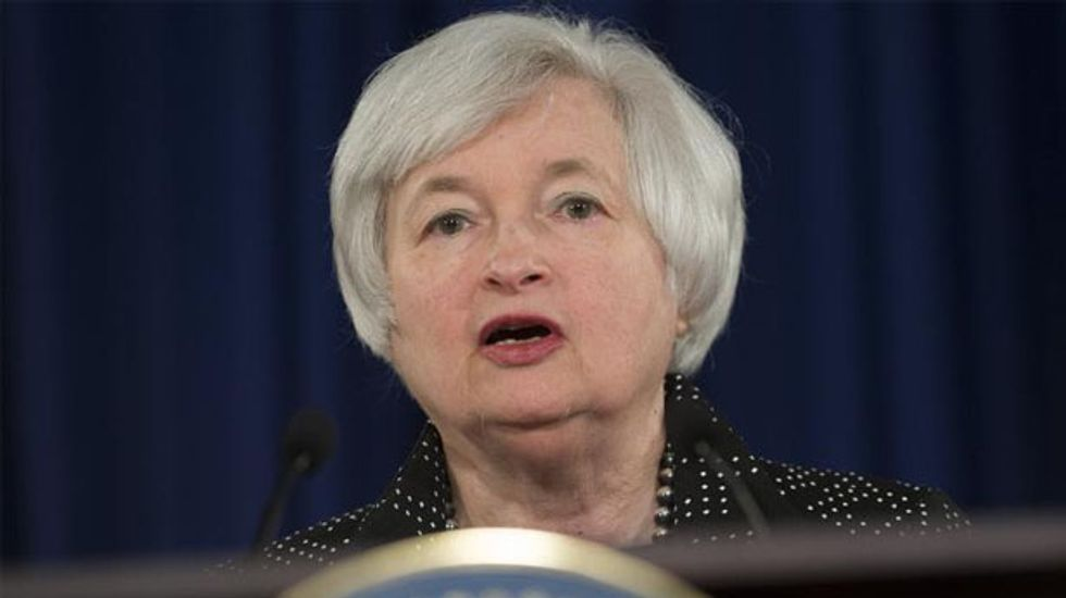 Federal Reserve holds course on lowered U.S. growth forecast