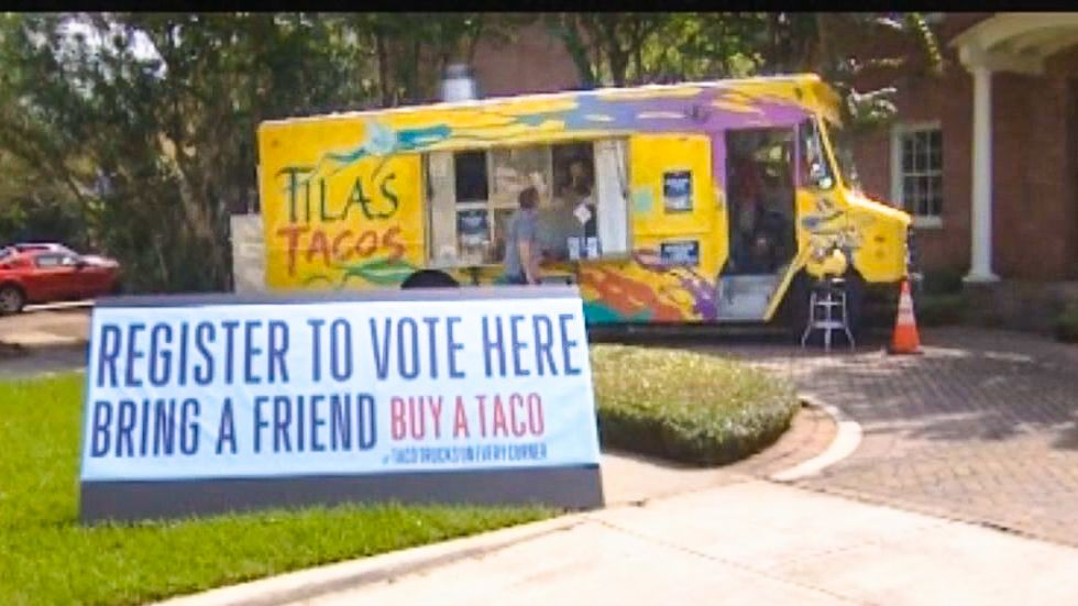 'Register to vote, get a taco': Houston taco trucks put voter registration booths 'on every corner'