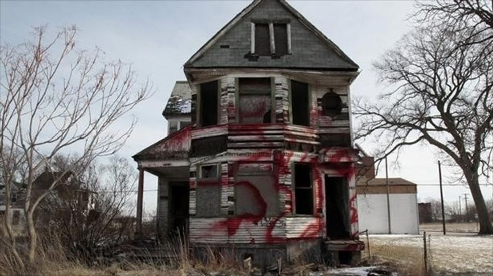 Bankrupt Detroit hit with new debts involving dump trucks and nuclear research