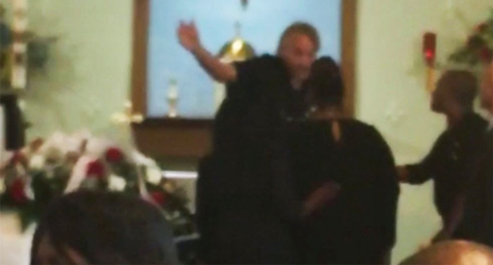 WATCH: Raging Maryland priest boots grieving black family out of funeral for chalice mishap -- then calls the cops