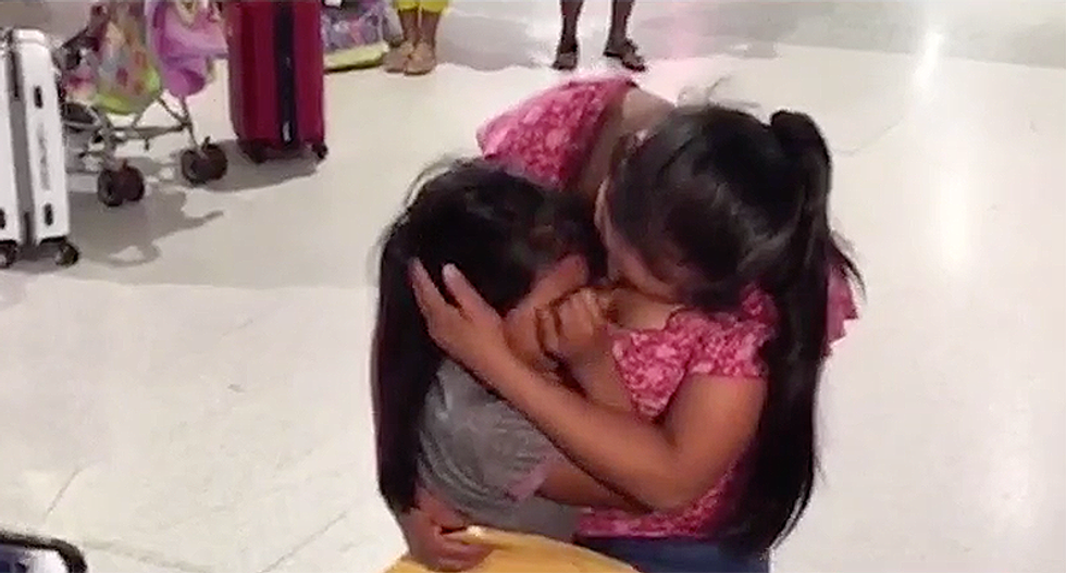 Migrant daughter doesn't want to let go after finally being reunited with her mother after 60 days