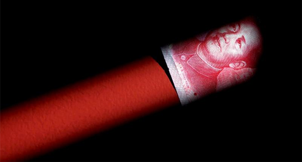 Major state-owned Chinese banks caught selling dollars to support yuan: sources