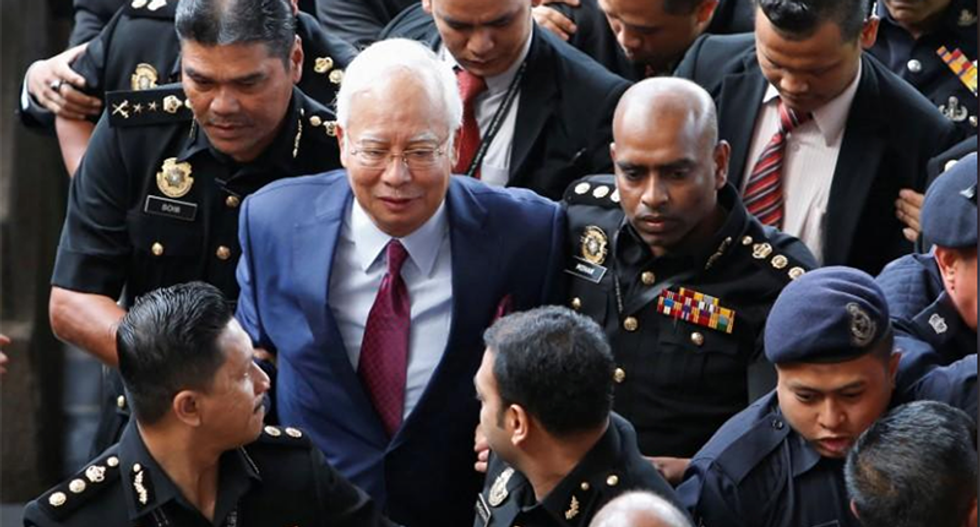 Former Malaysian prime minster pleads not guilty to breach of trust and abuse of power