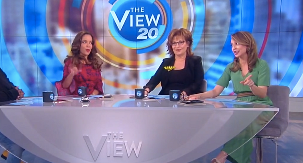 'She can't stand him': The View mocks video showing Melania slapping away Trump's hand