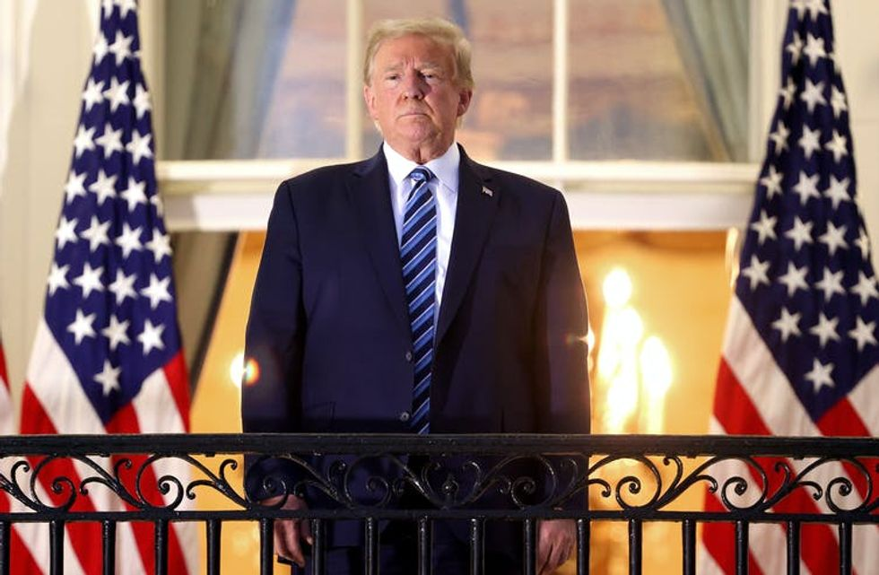 Trump stands, maskless, on the Truman Balcony