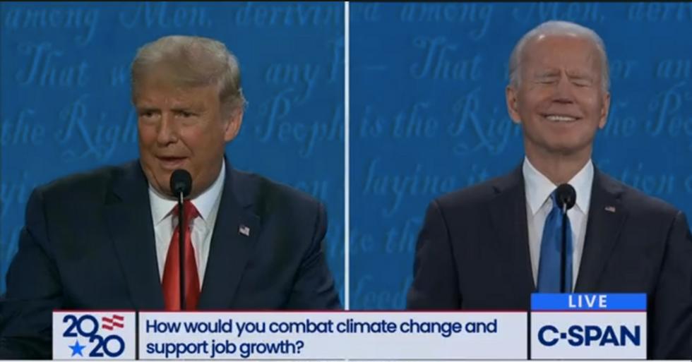 A screenshot from C-SPAN shows Trump talking while Biden laughs