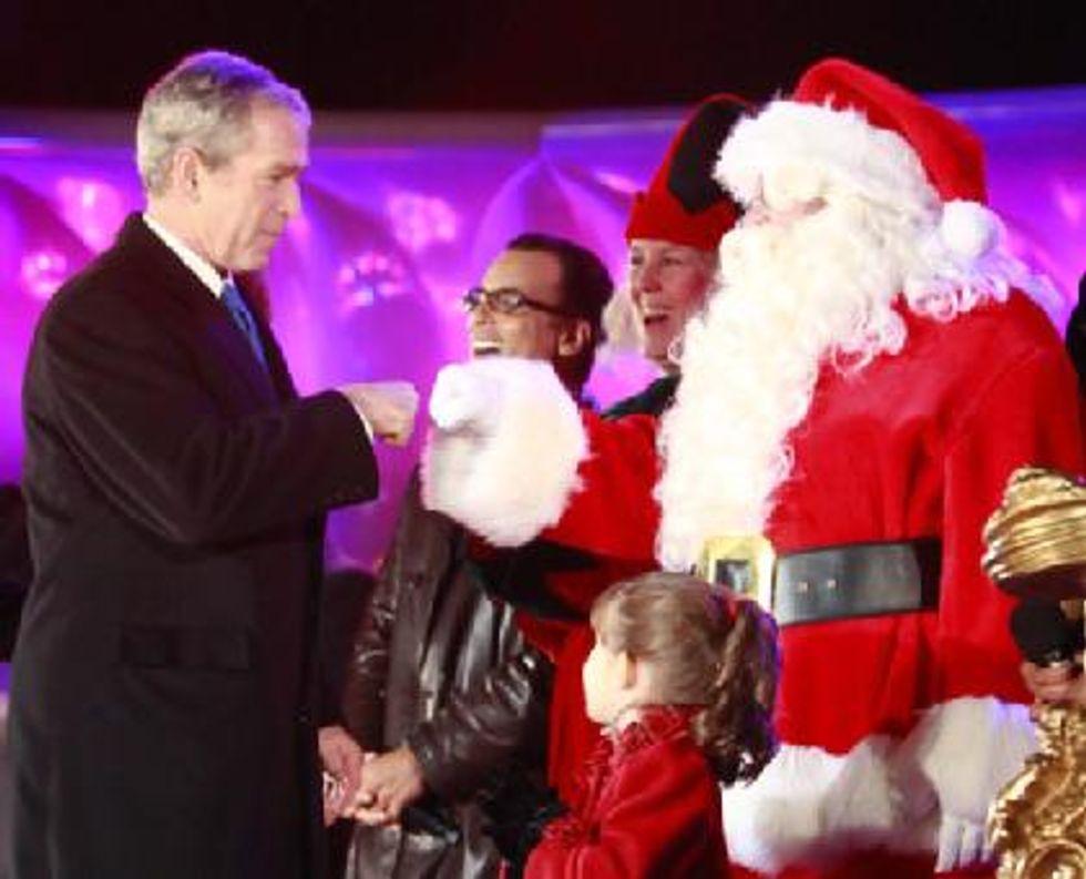 Bush gives Santa a fist bump
